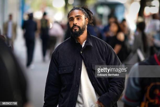 Jerry Lorenzo wears a black jacket a white tshirt outside 1017 ALYX 9SM during Paris Fashion Week Menswear SpringSummer 2019 on June 24 2018 in Paris...