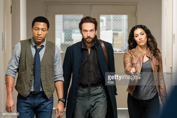 Jerry MacKinnon Tom Mison and Janina Gavankar in theSick Burn episode of SLEEPY HOLLOW airing Friday Feb 24 on FOX