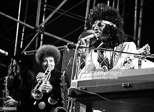 Jerry Martini Cynthia Robinson and Sly Stone of the rock and roll group Sly And The Family Stone perform onstage at the Los Angeles Free Clinic...