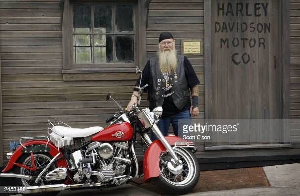 Jerry Mathews poses with his 1953 DuoGlide in front of a replica of the original HarleyDavidson workshop located on the grounds of the HarleyDavidson...