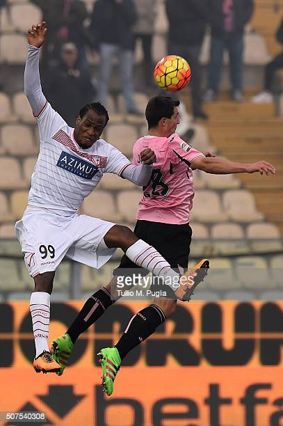 Jerry Mbakogu of Carpi and Mato Jajalo of Palermo jump for a header during the Serie A match between Carpi FC and US Citta di Palermo at Alberto...