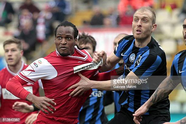 Jerry Mbakogu of Carpi FC battles for the ball with Andrea Masiello of Atalanta BC during the Serie A match between Carpi FC and Atalanta BC at...