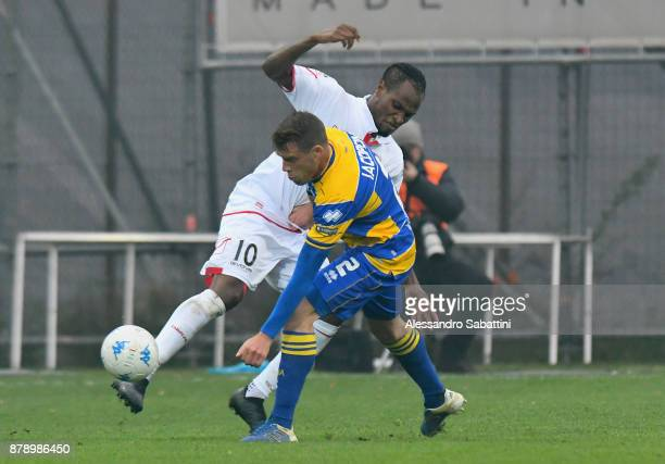 Jerry Mbakogu of FC Carpi competes for the ball whit Simone Iacoponi of Parma Calcio during the Serie B match between Carpi FC and Parma Calcio at...