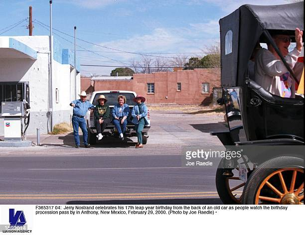 Jerry Nostrand celebrates his 17th leap year birthday from the back of an old car as people watch the birthday procession pass by in Anthony New...