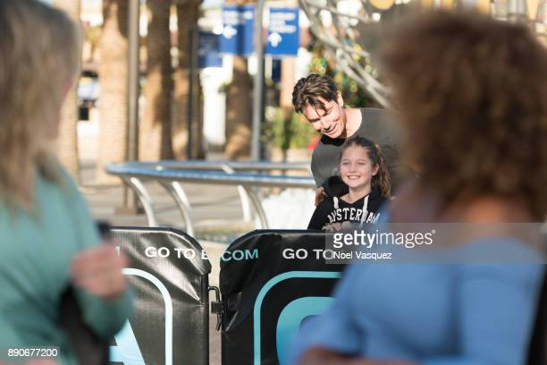 Jerry O'Connell and Charlie Tamara Tulip O'Connell visit Extra at Universal Studios Hollywood on December 11 2017 in Universal City California