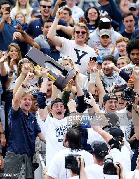 Jerry O'Connor of the Yale Bulldogs celebrates with fans after the Bulldogs defeat the Duke Blue Devils 1311 in the 2018 NCAA Division I Men's...