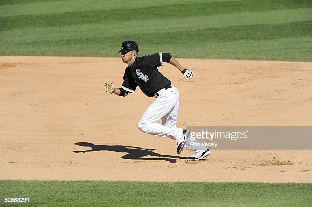Jerry Owens of the Chicago White Sox runs towards third base during the game against the Toronto Blue Jays at US Cellular Field in Chicago Illinois...