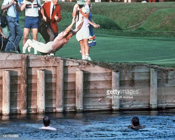 Jerry Pate jumps into the water hazard on the 18th hole after winning THE PLAYERS Championship held at THE PLAYERS Stadium course at TPC Sawgrass on...