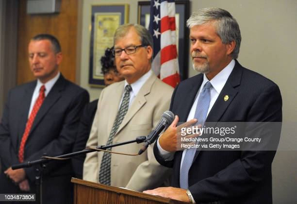 Jerry Powers, chief probation officer for Los Angeles County, right, announces at a press conference that 39 probation department employees have been...
