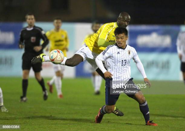 Jerry Prempeh of F91 and Reo Hatate of Japan battle for the ball during a friendly soccer match between F91 Diddeleng and the Japan U20 team at Stade...