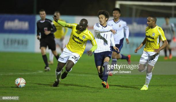 Jerry Prempeh of F91 and Tsukasa Morishima of Japan battle for the ball during a friendly soccer match between F91 Diddeleng and the Japan U20 team...