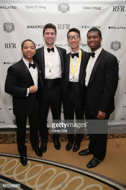 Jerry Registre Nolan Thomas Frank Zhou and Michael Wingate of The Harvard Krokodiloes attend as the Hasty Pudding Institute awards Derek McLane with...