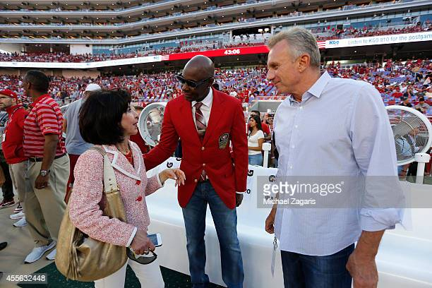 Jerry Rice and Joe Montana talk with Denise DeBartolo York on the sideline prior to the game between the San Francisco 49ers and the Chicago Bears at...