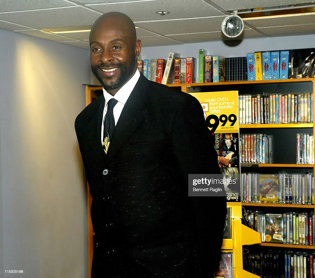 """Former NFL Star Jerry Rice Signs His Book """"Go Long"""" at Borders Books & Music in"""