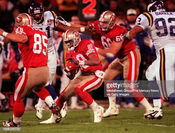 NEWS Jerry Rice having made one of his 14 receptions looks for room to run after the catch in the second quarter [951219 SP 4D 1] 4D RICE RUN...