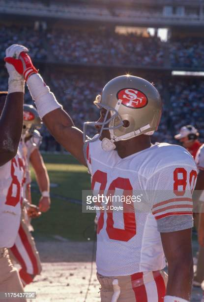 Jerry Rice high fives RG Guy McIntyre on the sidelines. San Francisco 49ers 48 vs San Diego Chargers 10 at Jack Murphy Stadium in San Diego,...