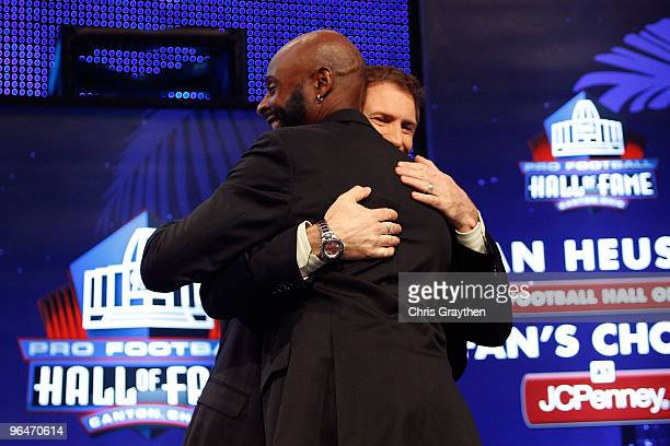 Jerry Rice is congratulated by fomer teammate Steve Young after Rice was announced as an 2010 enshrinee into the Hall of Fame during the Pro Football...