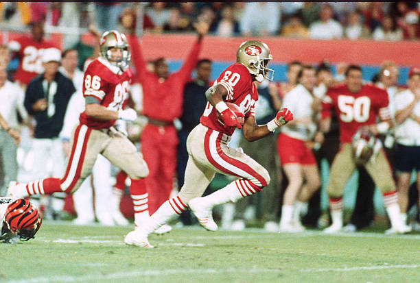 Jerry Rice of the San Francisco 49ers runs with the ball against the Cincinnati Bengals during Super Bowl XXIII on January 22, 1989 at Joe Robbie...