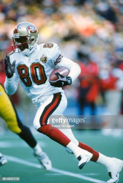 Jerry Rice of the San Francisco 49ers runs with the ball against the Pittsburgh Steelers during an NFL football game December 15 1996 at Three Rivers...