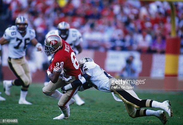 Jerry Rice of the San Francisco FortyNiners is tackled at Candlestick Park in San Francisco California