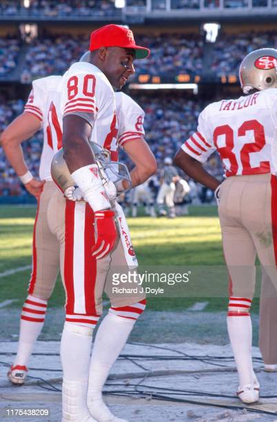 WR Jerry Rice on the sidelines with PR John Taylor San Francisco 49ers 48 vs San Diego Chargers 10 at Jack Murphy Stadium in San Diego California