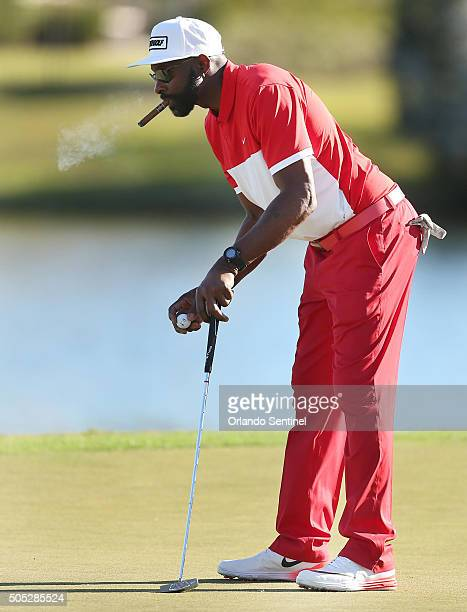 Jerry Rice puffs away on a cigar on the 18th green during the Diamond Resorts Invitational at The Golden Bear Club at Keene's Point in Wintermere Fla...