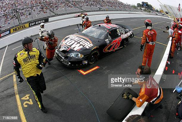 Jerry Robertson driver of the Furniture Row Chevrolet makes a pit stop during the NASCAR Busch Series Goody's 250 on July 22 2006 at Martinsville...