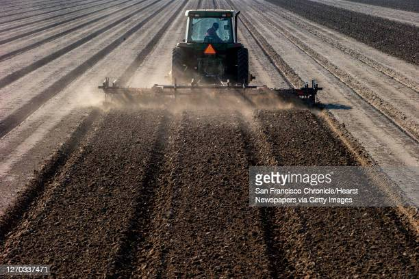 Jerry Robinson's farm is plowed in preparation for tomato seed planting, Wednesday, Feb. 26 in Stockton, Calif. Fishermen, water sports advocates,...