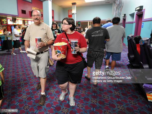 Jerry Ryan left takes his daughters Grace right with Joanie and their friend Kelsey Hatley to one of the final showings at the mall Scores of people...