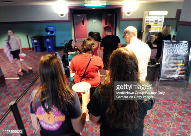 Jerry Ryan right takes his daughters Grace Joanie and their friend Kelsey Hatley to one of the final showings at the mall Scores of people came to...