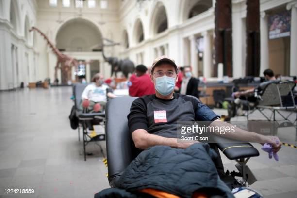 Jerry Schommer donates blood during an American Red Cross blood drive held at the Field Museum of Natural History on May 11, 2020 in Chicago,...