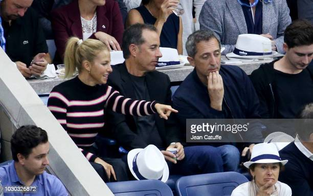 Jerry Seinfeld Jessica Seinfeld and french comedian Gad Elmaleh attend the men's final on day 14 of the 2018 tennis US Open on Arthur Ashe stadium at...