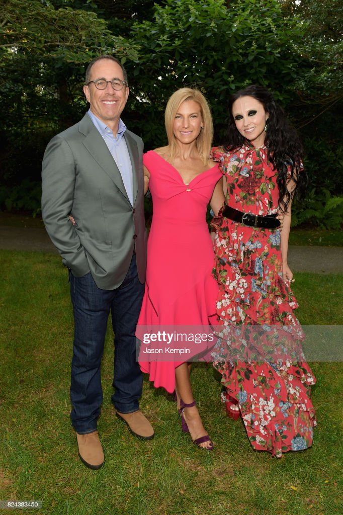 Jerry Seinfeld, Jessica Seinfeld and Stacey Bendet Eisner attend The GOOD+ Foundation's Hamptons Summer Dinner co-hosted by NET-A-PORTER on July 29, 2017 in East Hampton, New York.