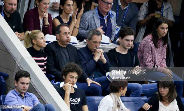 Jerry Seinfeld Jessica Seinfeld french comedian Gad Elmaleh and his son Noe Elmaleh attend the men's final on day 14 of the 2018 tennis US Open on...