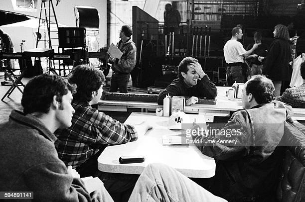 Jerry Seinfeld meets with his writers on the set of his hit television show Seinfeld during the filming of its final episode April 16 1998 in Studio...