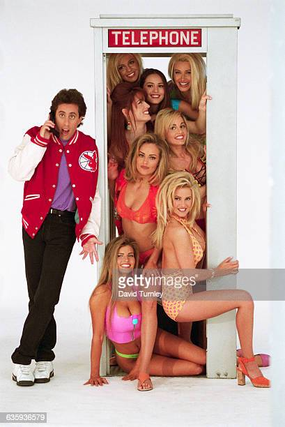 Jerry Seinfeld Next to a Phone Booth Full of Women
