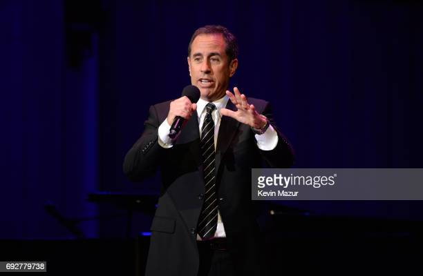 Jerry Seinfeld performs on stage at the National Night Of Laughter And Song event hosted by David Lynch Foundation at the John F. Kennedy Center for...