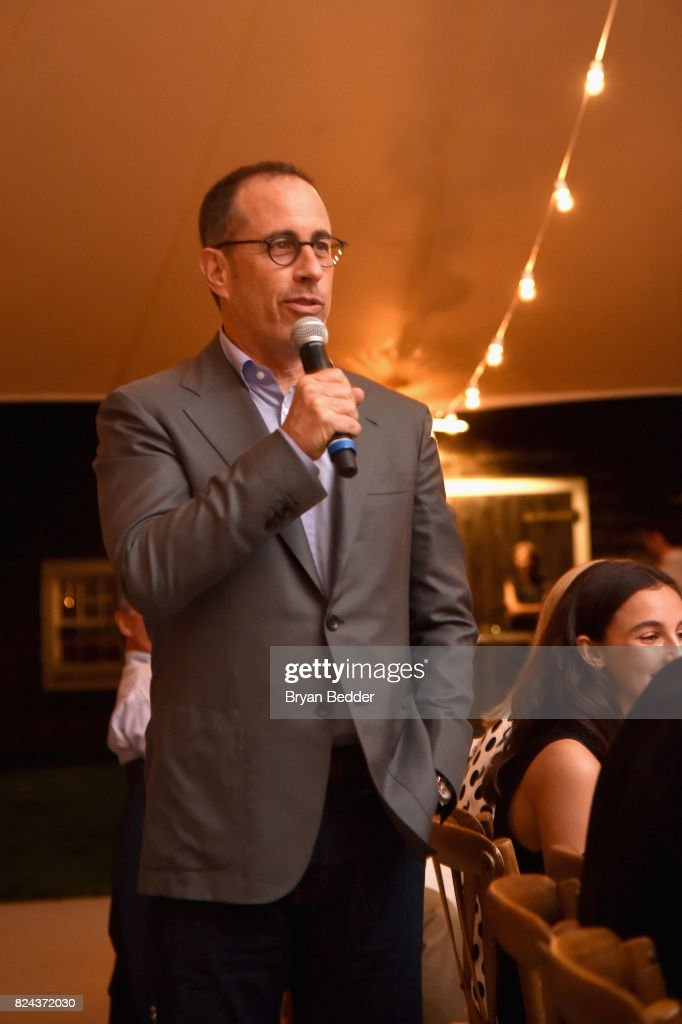 Jerry Seinfeld speaks to guests during The GOOD+ Foundation's Hamptons Summer Dinner co-hosted by NET-A-PORTER on July 29, 2017 in East Hampton, New York.