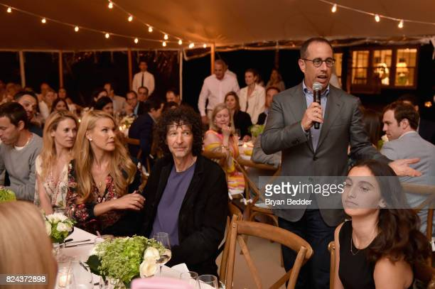 Jerry Seinfeld speaks to guests during The GOOD Foundation's Hamptons Summer Dinner cohosted by NETAPORTER on July 29 2017 in East Hampton New York