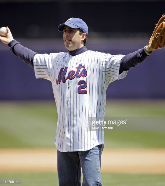 Jerry Seinfeld throws out the first pitch before a game between the New York Mets and the New York Yankees at Shea Stadium in Queens New York on...