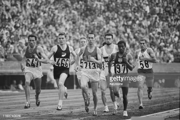 Jerry Siebert of the United States, Mamo Sebsibe of Ethiopia and Peter Snell of New Zealand during Heat Four of the Men's 800 metres competition on...