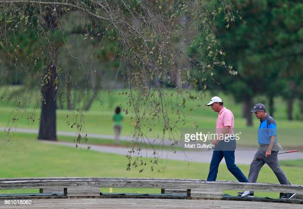 Jerry Smith and Scott Dunlap walk to the green on the third hole during the first round of the SAS Championship at Prestonwood Country Club on...