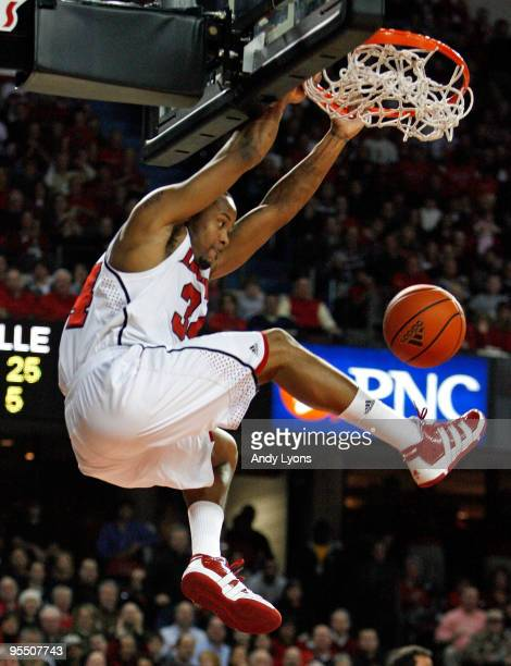 Jerry Smith of the Louisville Cardinals dunks the ball during the Big East Conference game against the South Florida Bulls at Freedom Hall on...