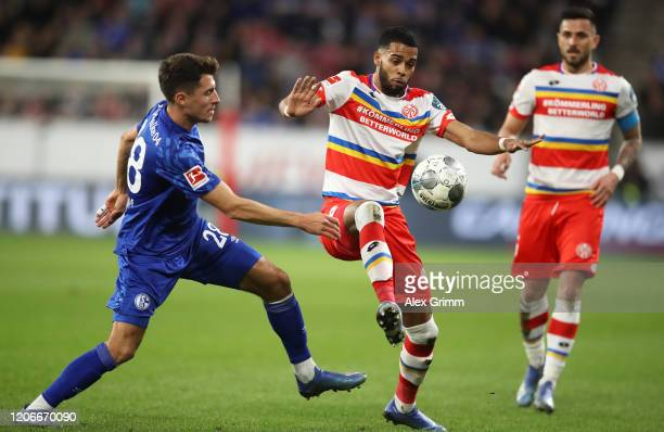 Jerry St Juste of FSV Mainz 05 is tackled by Alessandro Schöpf of FC Schalke 04 during the Bundesliga match between 1. FSV Mainz 05 and FC Schalke 04...