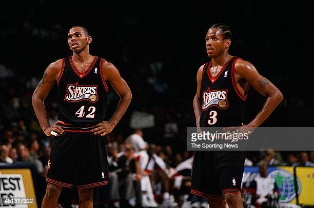Jerry Stackhouse and Allen Iverson of the Philadelphia 76ers stand on the court during the game against the Houston Rockets on November 12 1997 at...