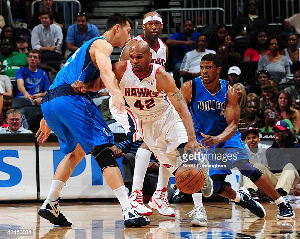 Jerry Stackhouse of the Atlanta Hawks drives against Yi Jianlian of the Dallas Mavericks on April 26 2012 at Philips Arena in Atlanta Georgia NOTE TO...