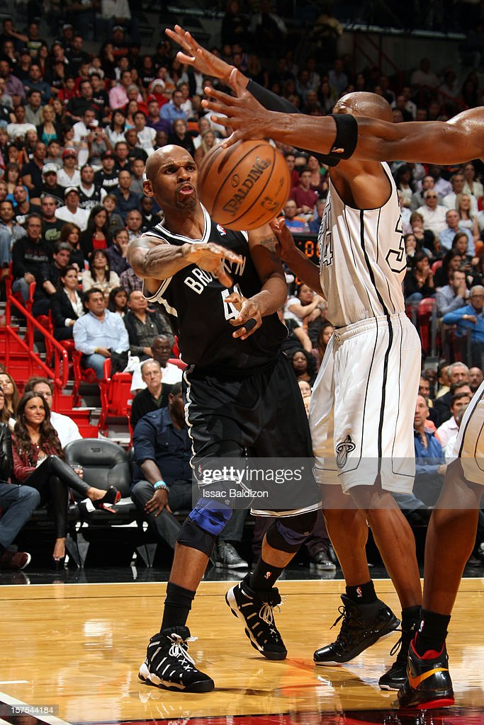 Jerry Stackhouse #42 of the Brooklyn Nets makes a pass against the Miami Heat on December 1, 2012 at American Airlines Arena in Miami, Florida.
