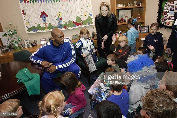 Jerry Stackhouse of the Dallas Mavericks answers questions from the first graders in contest winner Carlee Miller's class at Carroll Elementary...