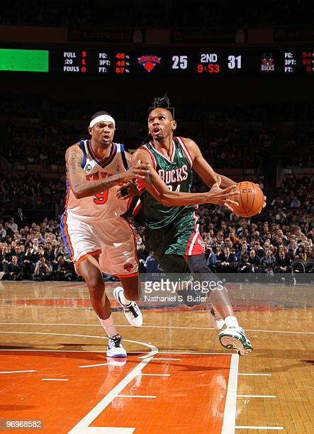 Jerry Stackhouse of the Milwaukee Bucks drives against Jonathan Bender of the New York Knicks on February 22 2010 at Madison Square Garden in New...
