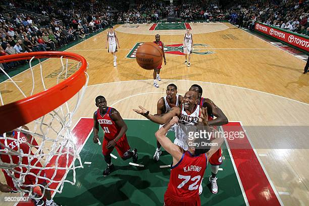 Jerry Stackhouse of the Milwaukee Bucks shoots a layup against Jason Kapono of the Philadelphia 76ers on March 24 2010 at the Bradley Center in...